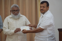 handing-over-the-amount-for-house-construction